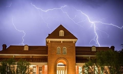 Old Main in a lightning storm