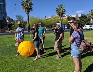 Dr. Kortencamp and POEM students on UA mall during solar system modeling